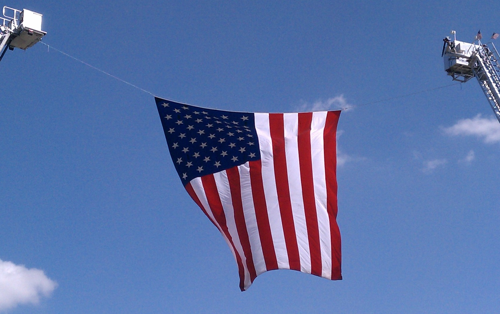 Large flag hanging from cranes displayed at the 9/11 10 year remembrance ceremony in Omaha.