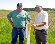 Gary Zoubek, UNL Extension shows a producer how to install and use an ET gage.