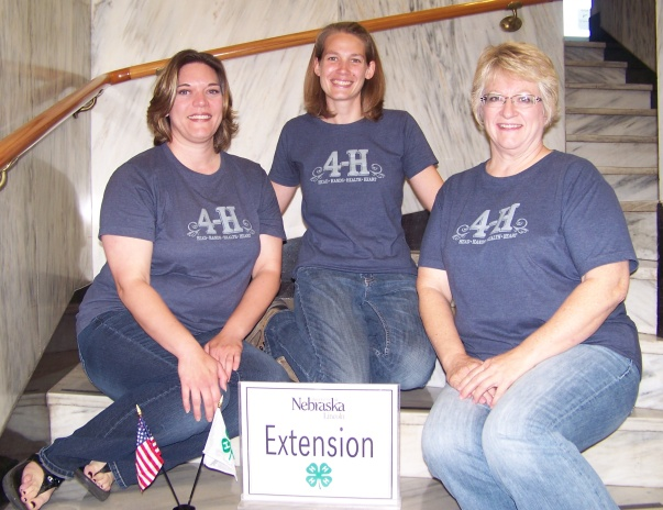 UNL Extension Office in Clay County Wearing 4-H t-shirts during National 4-H Week.