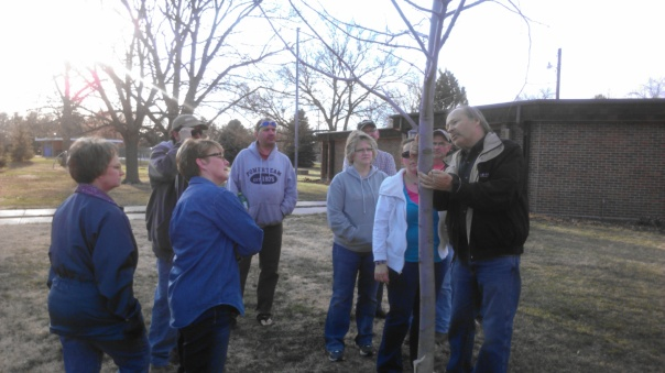 Scott Dewald showing workshop attendees where the bark collar ridge occurs on this branch.